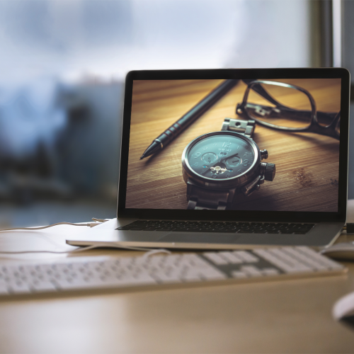 mockup-featuring-a-macbook-placed-on-a-desk-at-an-office-2441-el1-1